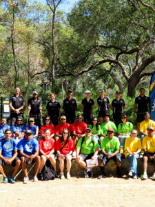 group of people on cultural amazing race in bright coloured shirts in bushland