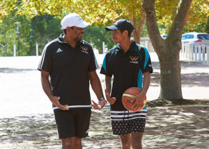 david wirrpanda walking with young adult male holding basketball