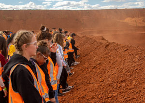 group of deadly sista girlz in high vis at red dirt mine site