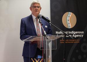 minister ken wyatt making a speech at a lectern