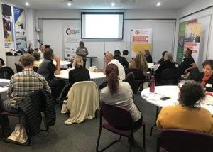 a group of indigenous business clients at a seminar