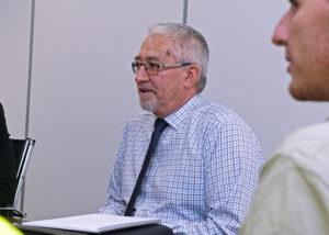 wirra hub general manager shane devitt at desk in meeting