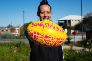 alisha roberts holding deadly sista girlz branded football