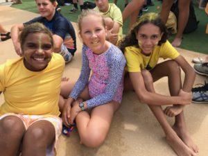 3 teenage girls in swim suits at school carnival
