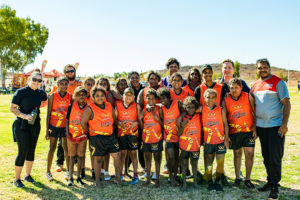 wiluna rsas students in football uniforms standing in group
